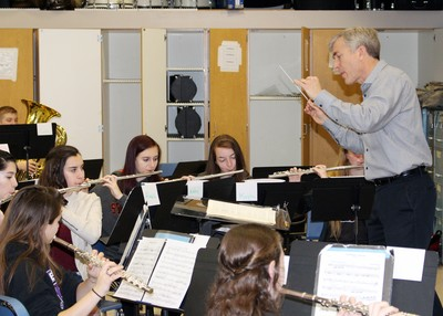 Dr. Paul Shewan conducts the High School Wind Ensemble