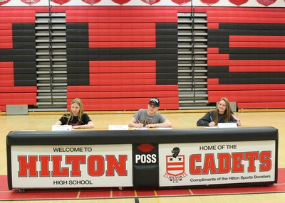Sarah Gerken, Sarah Gerken, Austin Hertel and Bailey Klafehn sign their letters of intent